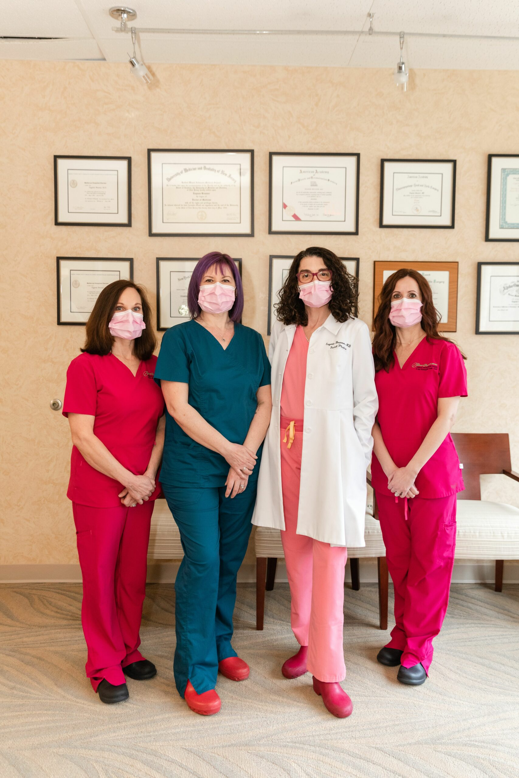 Group photo of Dr. Eugenie Brunner with her staff wearing masks following COVID protocols in their office in Princeton, NJ.