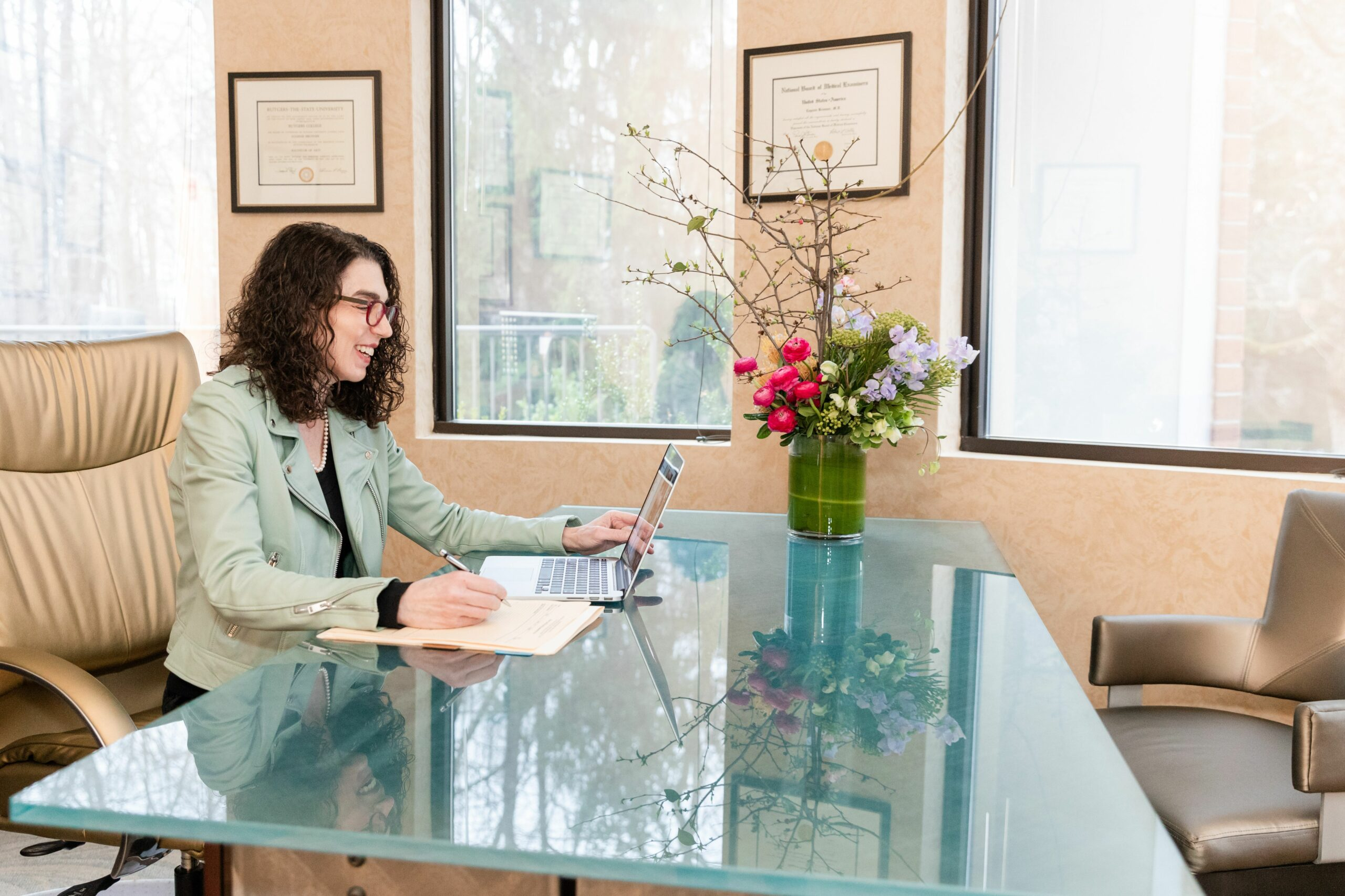 Dr. Eugenie Brunner giving a virtual consultation in her office, NYC
