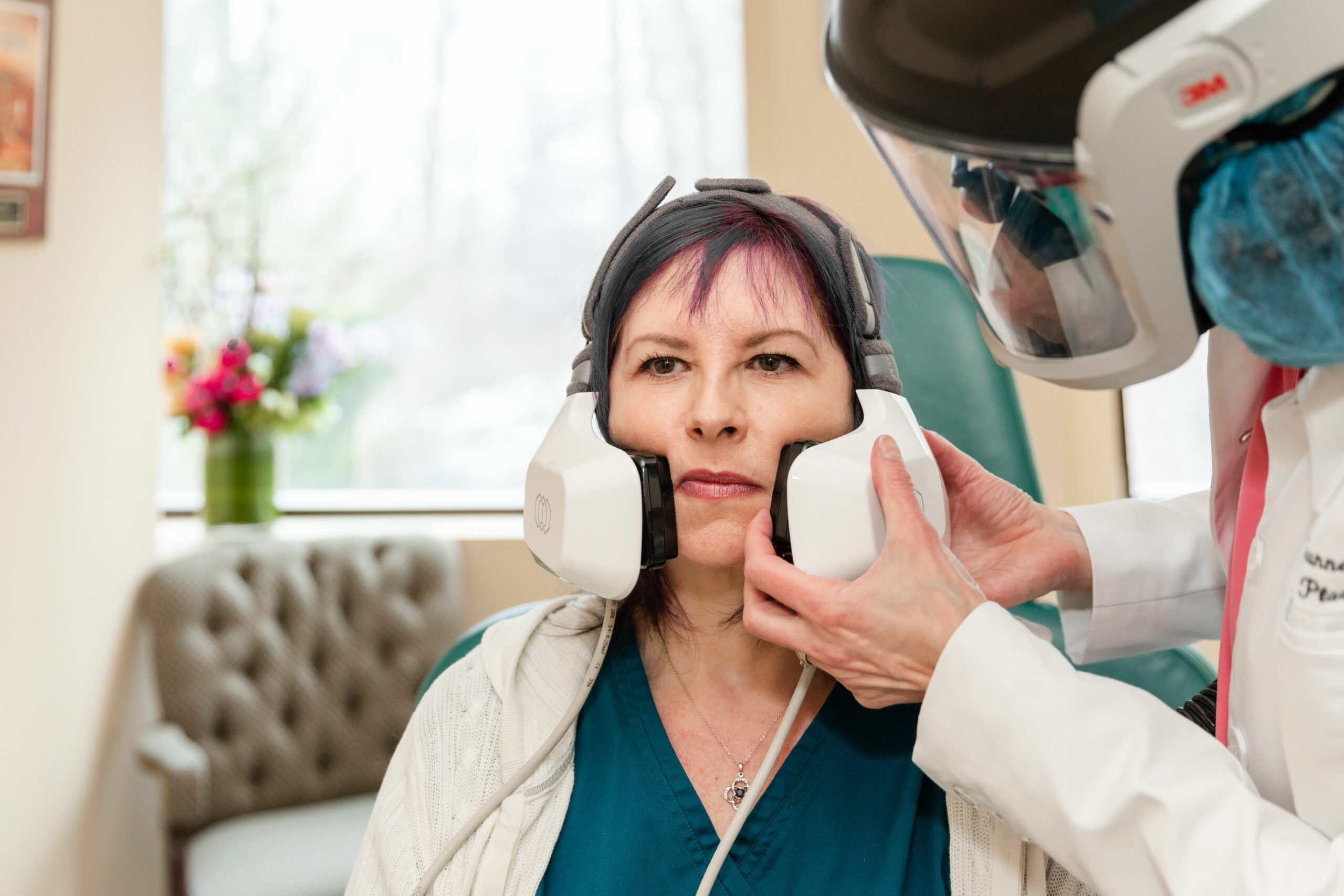 Patient receiving a non-surgical neck lift with Evoke facial remodeling in Princeton, NJ
