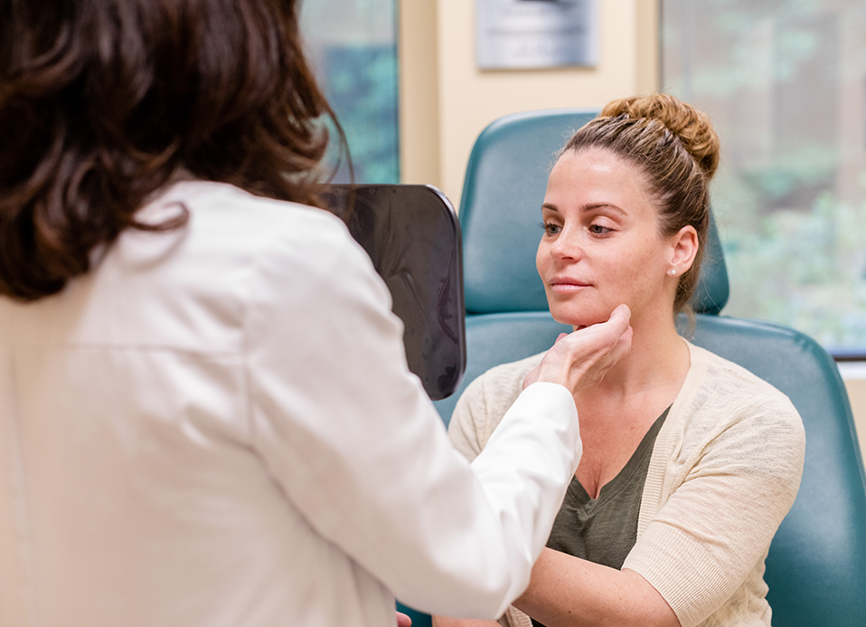 Patient looking in the mirror during her consultation with Dr. Brunner for the Tri Zone Laser Lift in Princeton, NJ