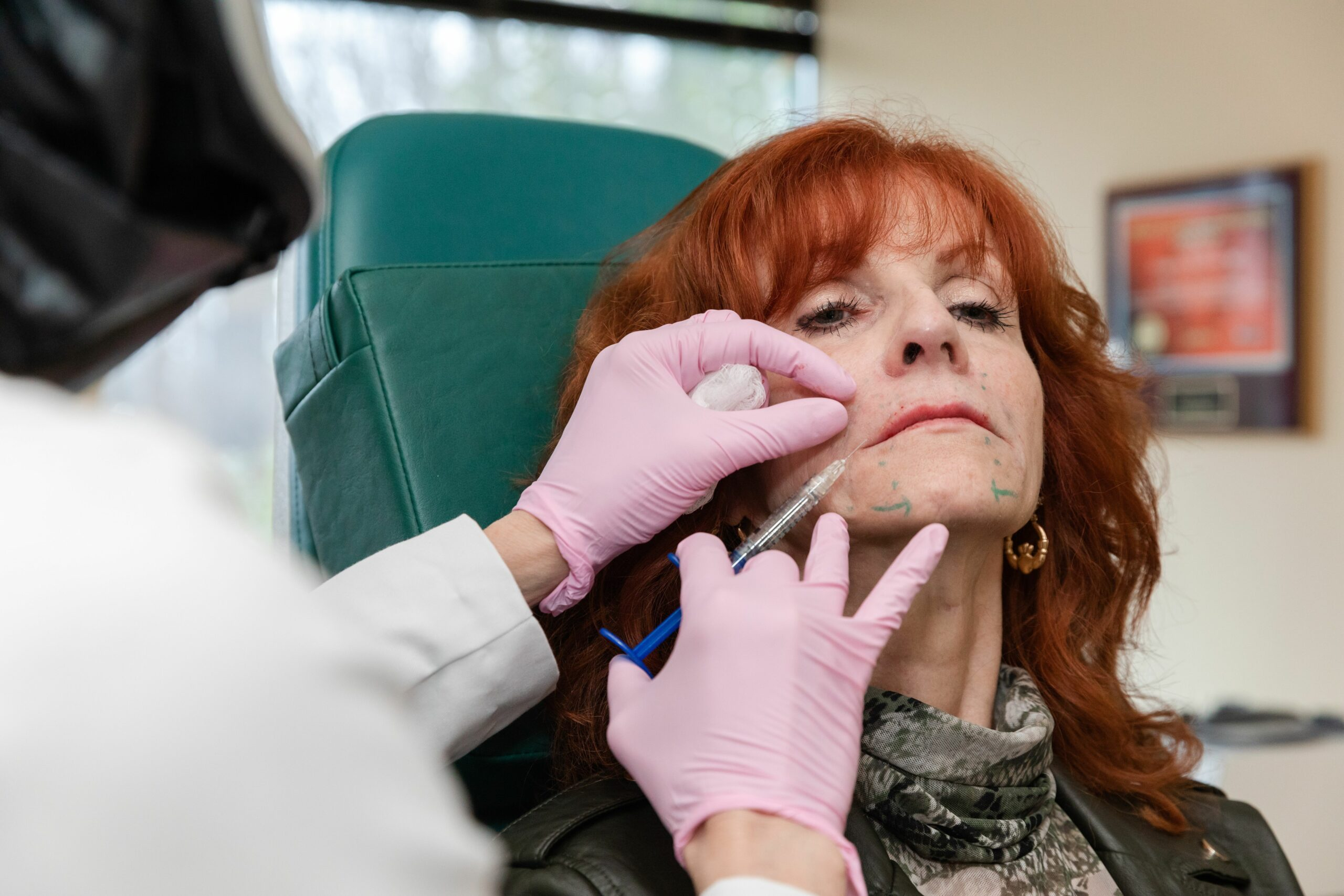 A woman is getting botox and dermal fillers from Dr. Eugenie Brunner for a youthful skin, Princeton, NJ.