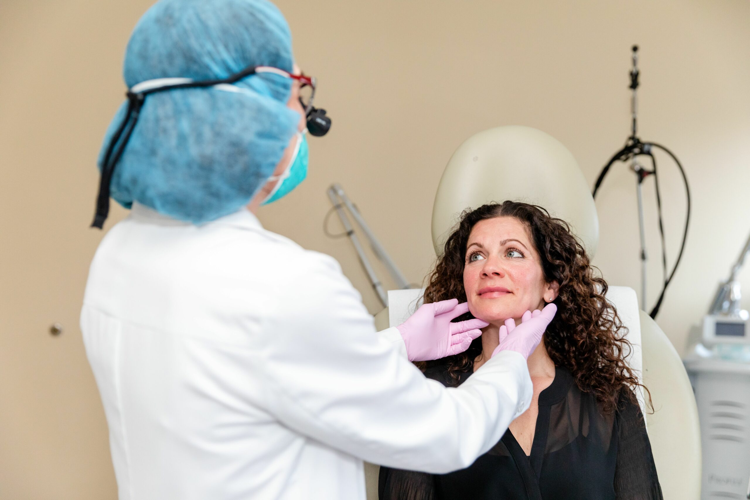 Dr. Brunner consulting with a patient interesting in a non-surgical neck lift in Princeton, NJ
