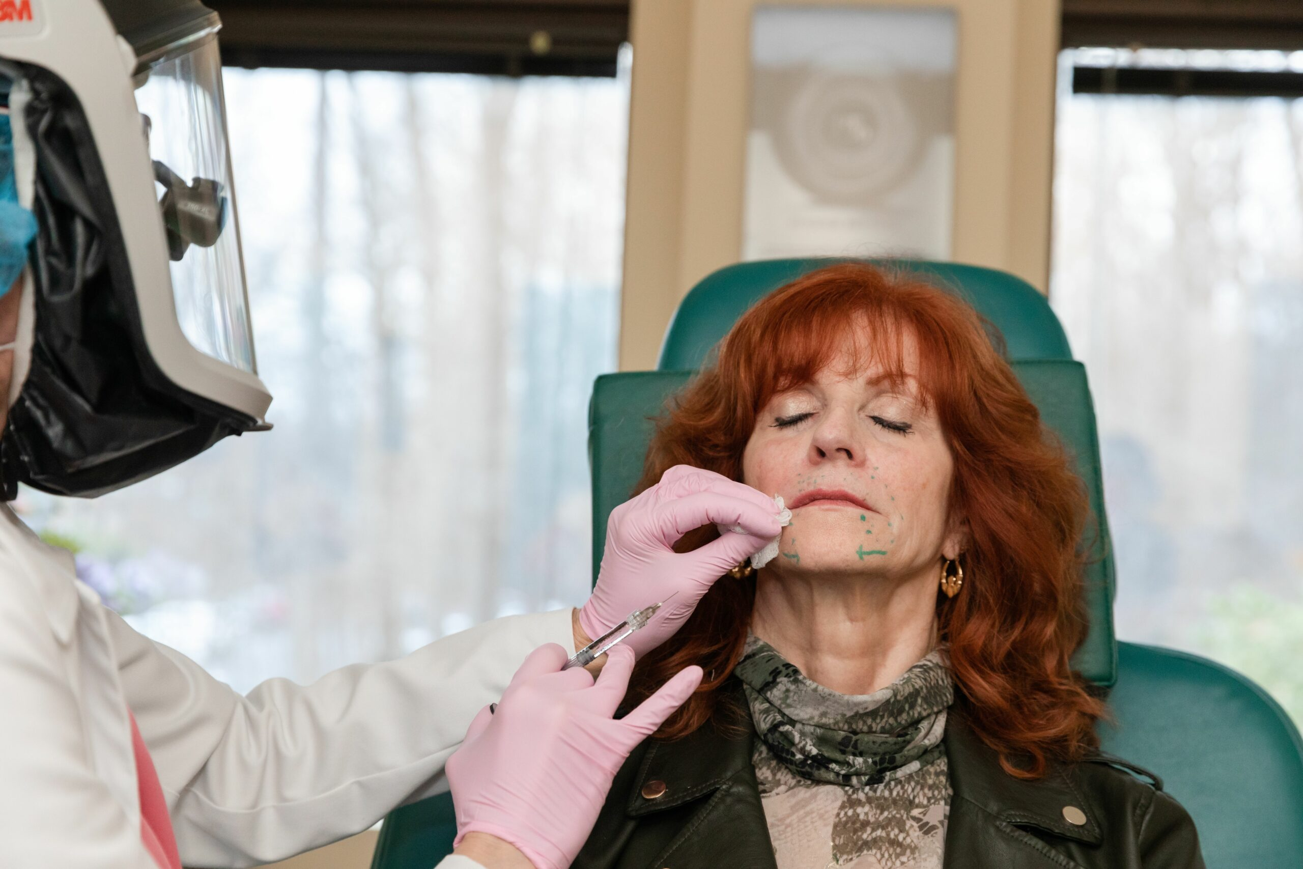 Board certified dermatologist Dr. Eugenie Brunner, MD FACS is injecting Bellafill injectable around the mouth of her patient for a youthful appearance in Princeton, NJ